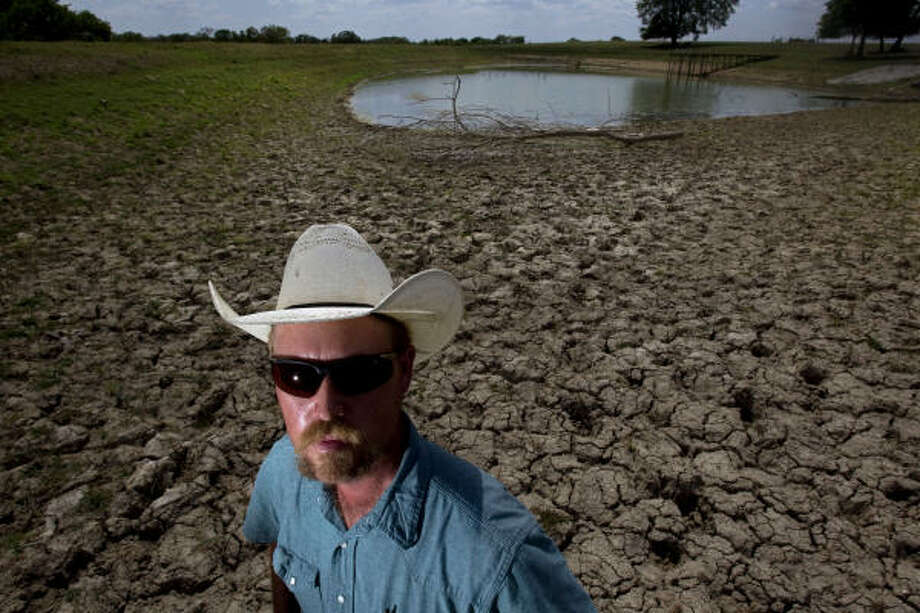 """We've seen bad before, but this is past it. We've seen nothing like this,"" says Bo Poole, who farms 740 acres in Montgomery County. In a normal year, his irrigation pond would be full. Photo: Johnny Hanson, Chronicle"