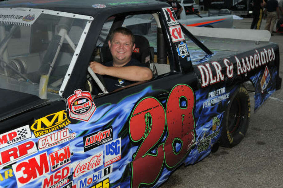 JERRY BAKER: FOR THE CHRONICLE AT THE WHEEL: Kevin Wiseman, 30, a graduate of Klein Oak High School, is a Woodlands firefighter who spends his spare time racing trucks at Houston Motorsports Park. Photo: Jerry Baker, For The Chronicle