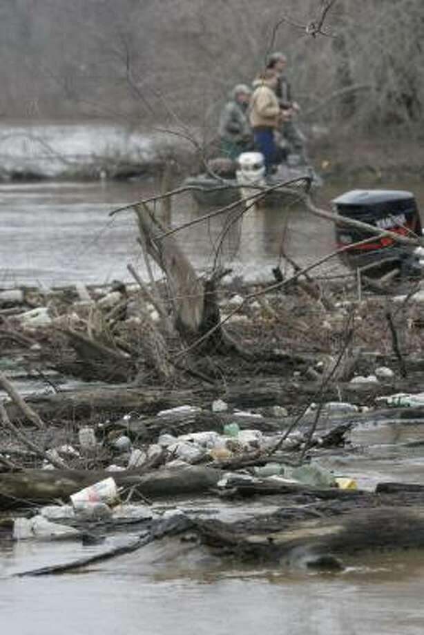 Few public places escape being trashed by the shameful, irresponsible and criminal behavior of those who use the outdoors as a garbage can. This isolated piece of the Sabine River held rafts of floating refuse trapped among downed trees. Photo: Shannon Tompkins, Chronicle