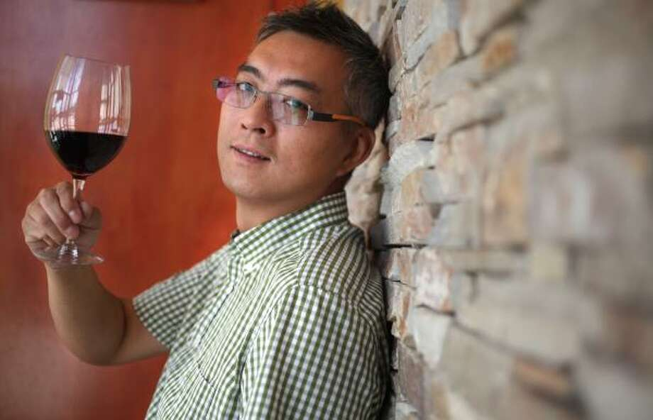 Ron Chen, owner of Rattan Pan-Asian Bistro & Wine Bar, a restaurant in the Energy Corridor, describes his restaurant as serving a little bit of everything. Photo: Mayra Beltran, Chronicle