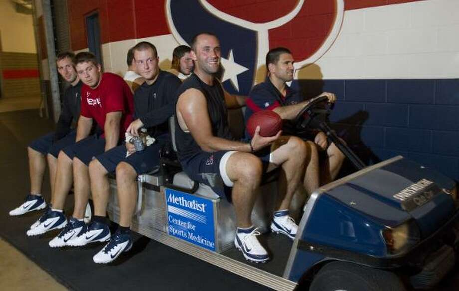 Matt Schaub (with ball) and Co. were excited to get back to work at Reliant Stadium on Tuesday. Photo: Brett Coomer, Chronicle