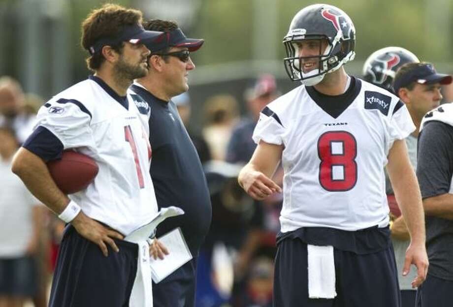 Texans quarterback Matt Leinart, left, has watched from the sidelines because of a rule keeping him from practicing until today. Photo: Brett Coomer, Chronicle