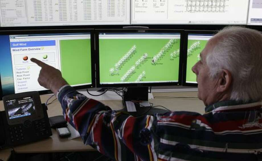 Richard Laudone, an operator in the control center at Pattern Energy, monitors turbine generators at the Gulf Wind project south of Kingsville. Photo: Melissa Phillip:, Chronicle