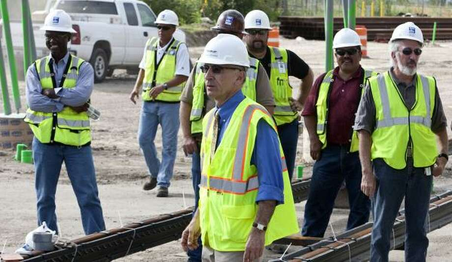 METRO President and CEO George Greanias, center, is on hand Wednesday as the first concrete is poured for the transit agency's Southeast (Purple) line at Paige and Rusk. Photo: James Nielsen, Chronicle