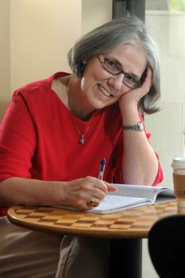 JERRY BAKER: FOR THE CHRONICLE PEN TO PAPER: Carolyn Boyd, of The Woodlands, relaxes at Starbucks in the Pinecroft Shopping Center, where she writes most of her poetry. Photo: Jerry Baker, For The Chronicle
