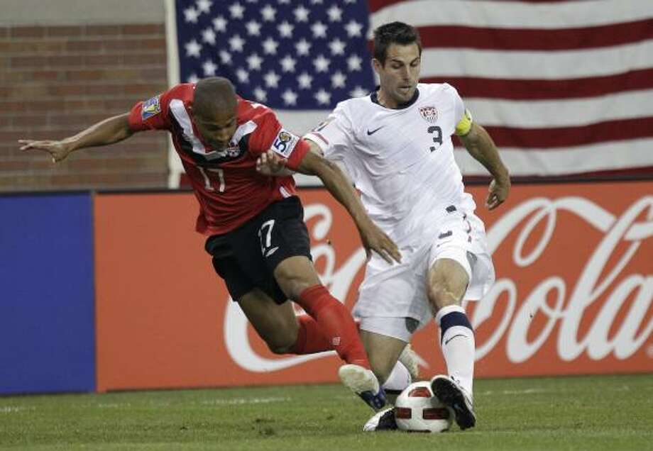 U.S. captain Carlos Bocanegra, right, says the squad has already achieved its original goal of reaching the knockout stage. Photo: Paul Sancya, Associated Press