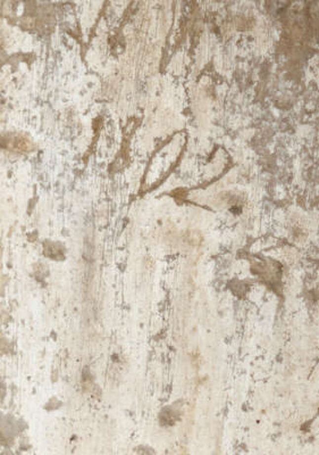 "An etching of ""1802"" is on a wall by the window over the main doorway to the Alamo. It was uncovered recently. Photo: Associated Press"