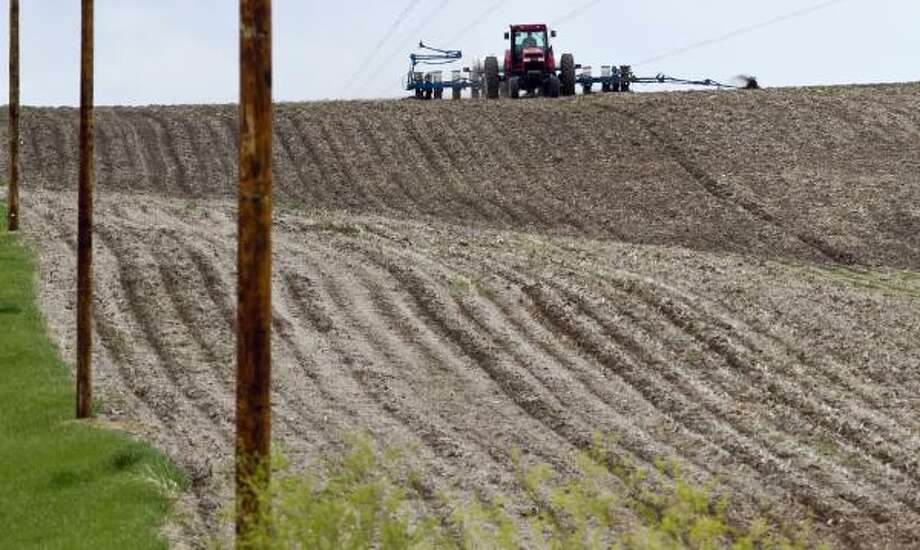 A farmer plants corn near Yutan, Neb. Farmers have planted the second-largest corn crop in nearly seven decades this spring. The huge crop could ease a grain shortage and keep food prices from rising over the next six months. Photo: Nati Harnik:, Associated Press