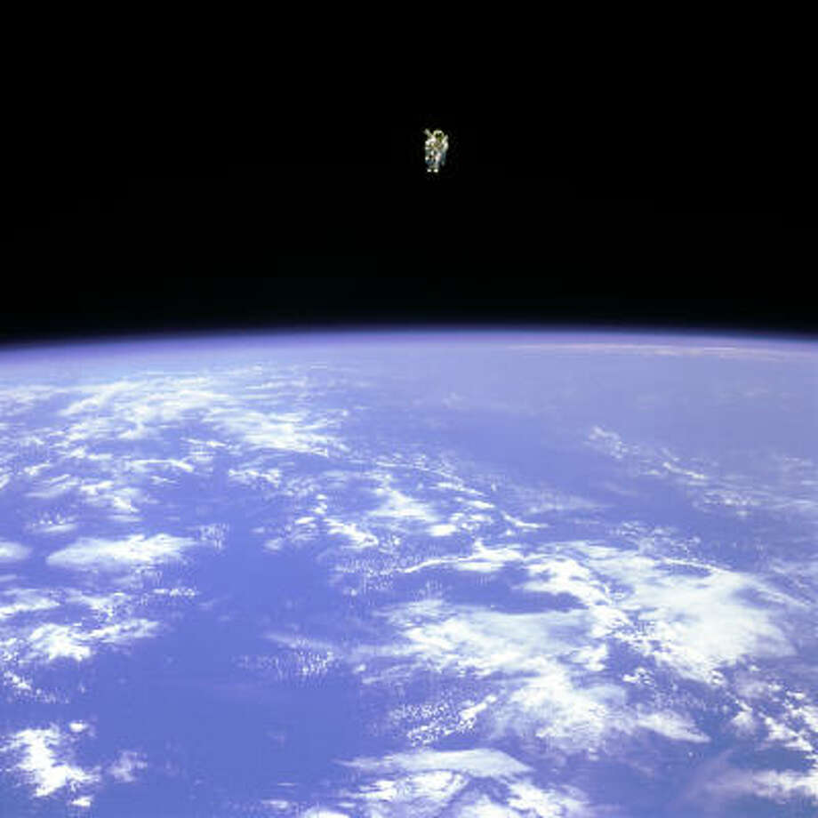 A nitrogen jet-propelled backpack helps Bruce McCandless II journey 320 feet from shuttle Challenger during the first untethered spacewalk in 1984. Photo: NASA