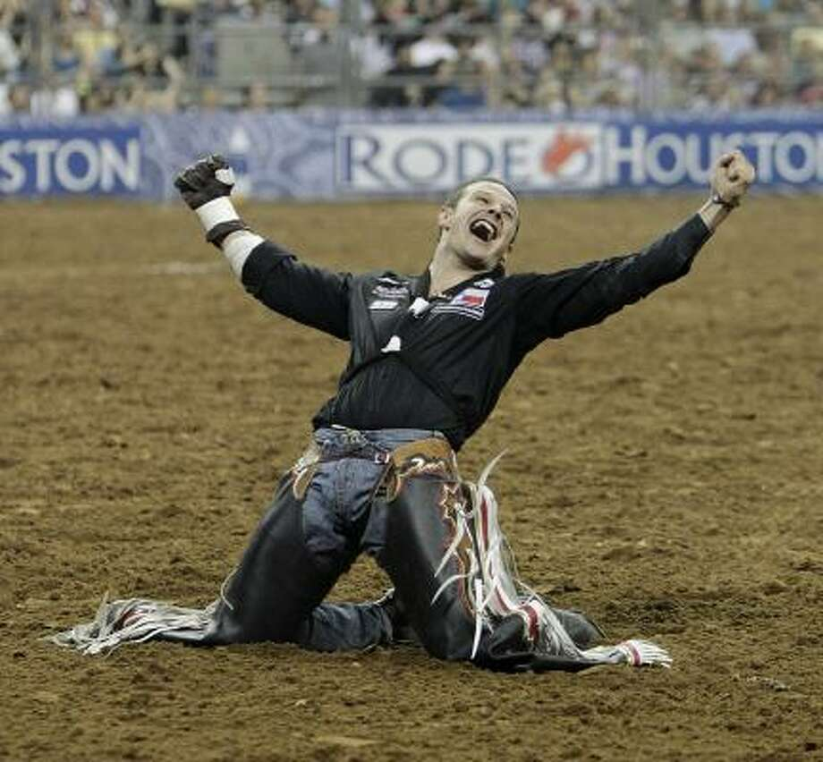 Clint Cannon struck this pose after winning the bareback riding title at this year's Houston Rodeo. The Waller native recently celebrated another big win. Photo: Karen Warren, Chronicle