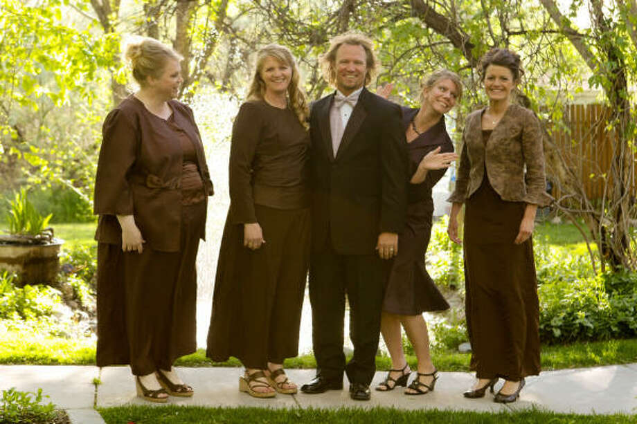 Kody Brown, center, stars with his wives, from left, Janelle, Christine, Meri, and Robyn in TLC's reality TV show, 'Sister Wives.' The Browns are challenging Utah's ban on plural marriages. Photo: ASSOCIATED PRESS | TLC
