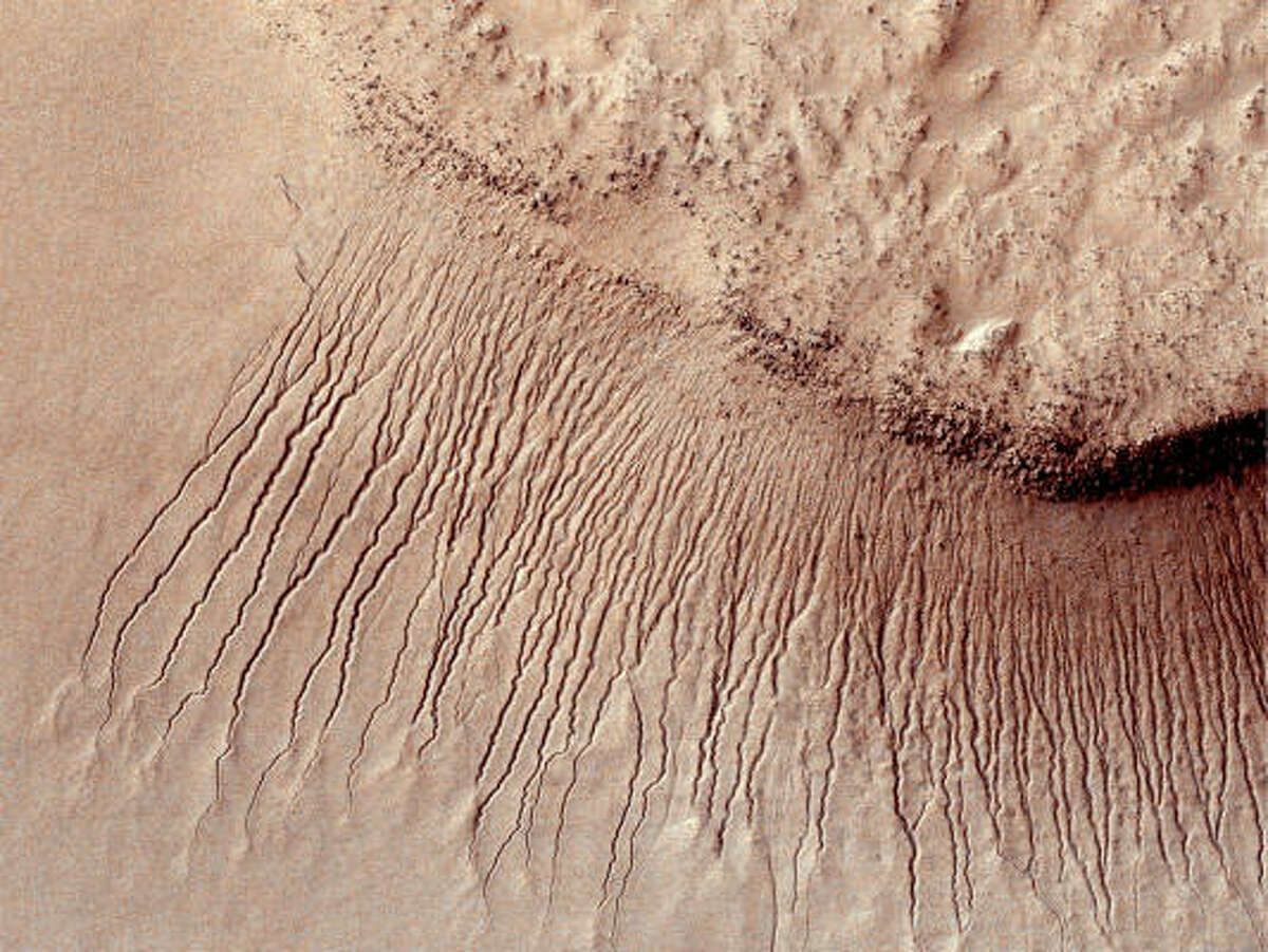 Scientists believe these lines seen on some slopes on Mars may be evidence of flowing salt water.