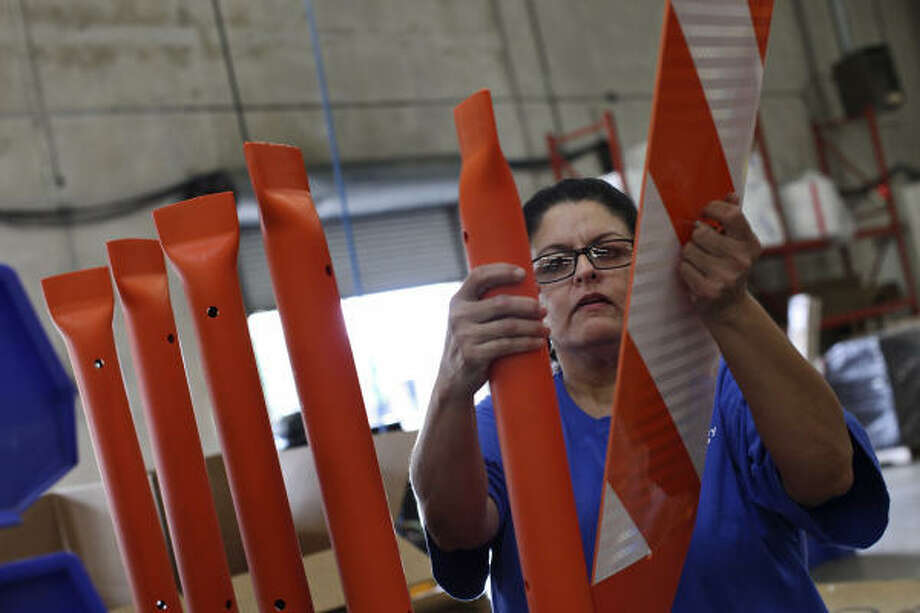 Lisa Salas prepares work-zone panels at San Antonio's Impact Recovery Systems. The company has a growing U.S. and European customer base. Photo: Lisa Krantz :, San Antonio Express-News