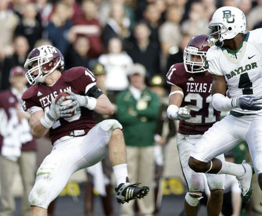 A&M linebacker Kyle Mangan, left, is expected to compete for a starting job this fall. Photo: Brett Coomer, Chronicle