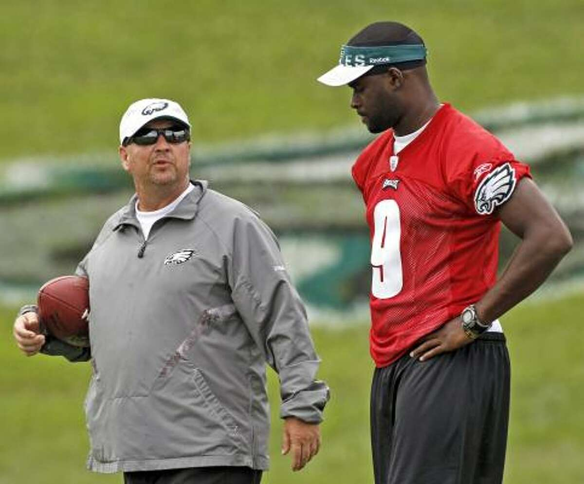 Eagles offensive coordinator Marty Mornhinweg, left, marvels at Vince Young's talent and looks forward to molding him into an elite quarterback.