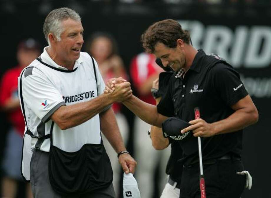 Caddie Steve Williams, left, and Adam Scott see quick results from their new partnership. Photo: Phil Masturzo, McClatchy-Tribune News Service