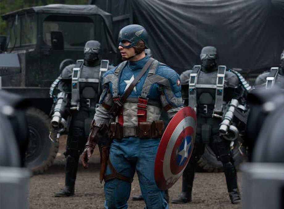 Captain America (Chris Evans, center), surrounded by Hydra soldiers in Captain America: The First Avenger. Photo: Jay Maidment, Marvel Studios