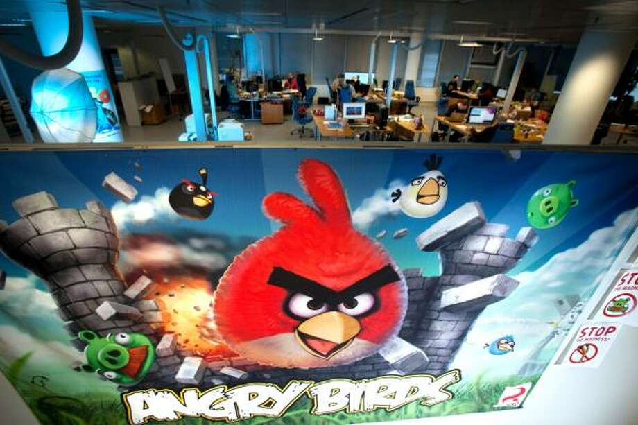 "Animation graphics from the computer game ""Angry Birds"" are featured at the headquarters of Rovio Mobile in Espoo, Finland. The company says writers are developing a script for a movie that would fill in the back story of the birds. Photo: Henrik Kettunen:, Bloomberg"