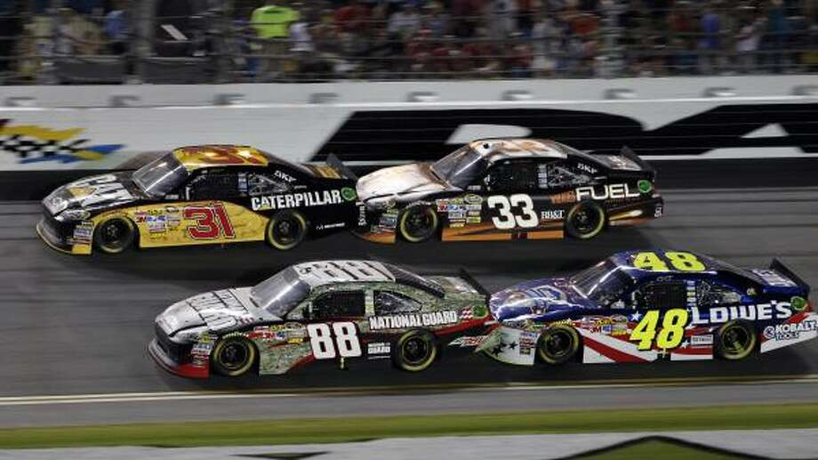 Fans of Dale Earnhardt Jr. (88) accused Hendrick Motorsports teammate Jimmie Johnson (48) of sabotaging Earnhardt's chance to win on Saturday night. Photo: Terry Renna, Associated Press
