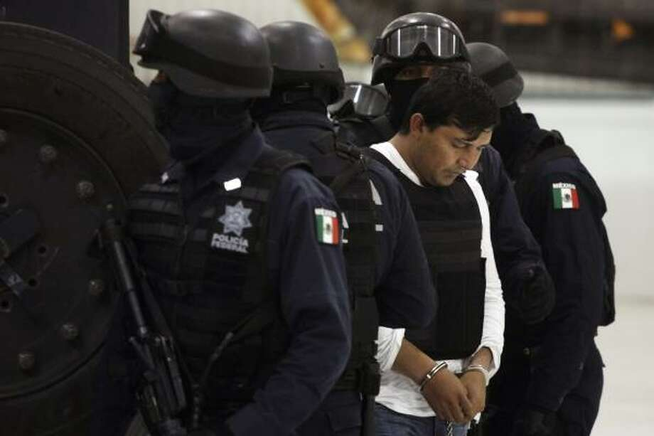 Jesus Enrique Aguilar was arrested in Atizapan. Photo: Alexandre Meneghini, Associated Press