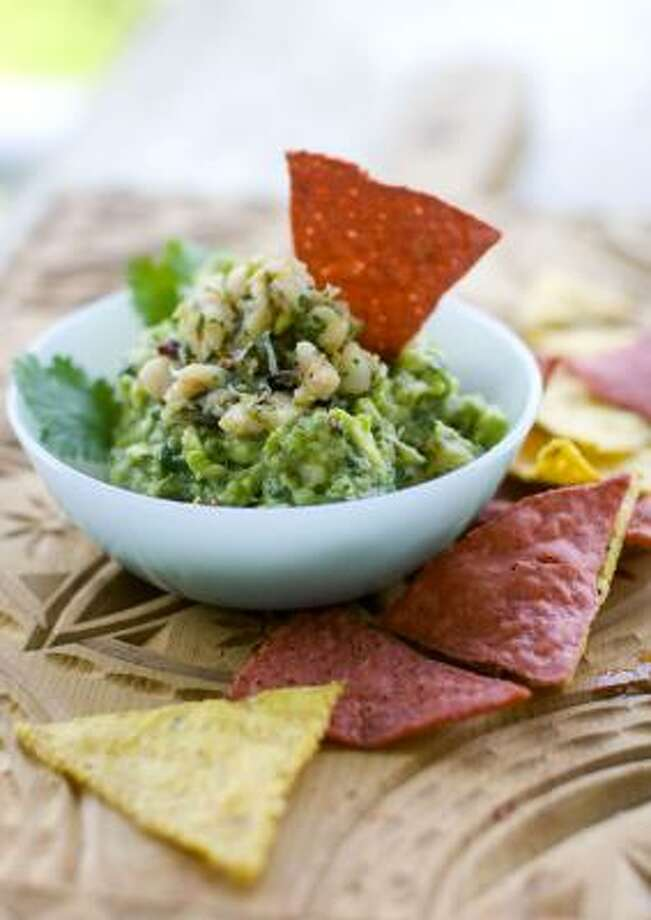 How many times have you ruined your appetite by eating too much guacamole. Take the dip to the next level (and possibly make it a meal on its own) by adding seafood. Get the recipe here.  Photo: Matthew Mead, Associated Press