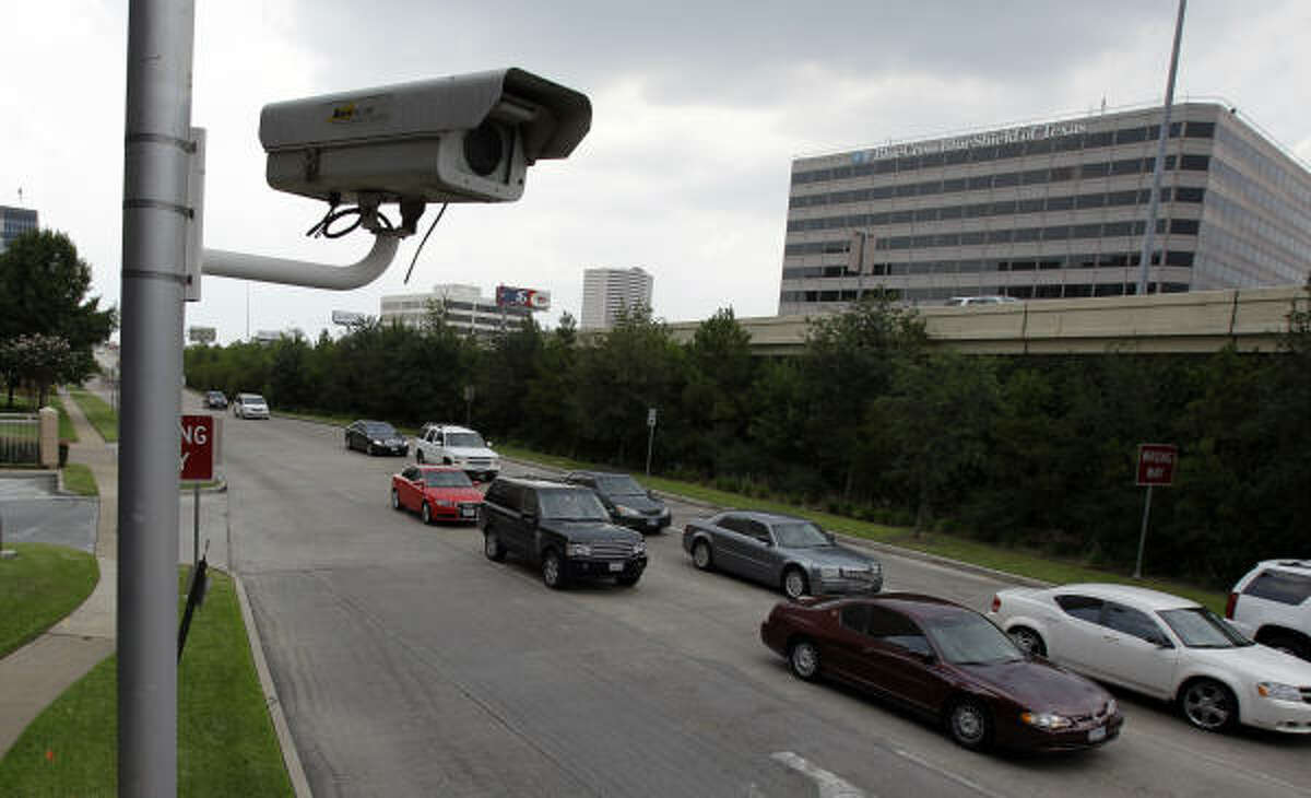 A red-light camera sits at the intersection of the 610 West Loop South feeder and Westheimer. Starting Sunday, citations will be issued at 50 intersections around the city.