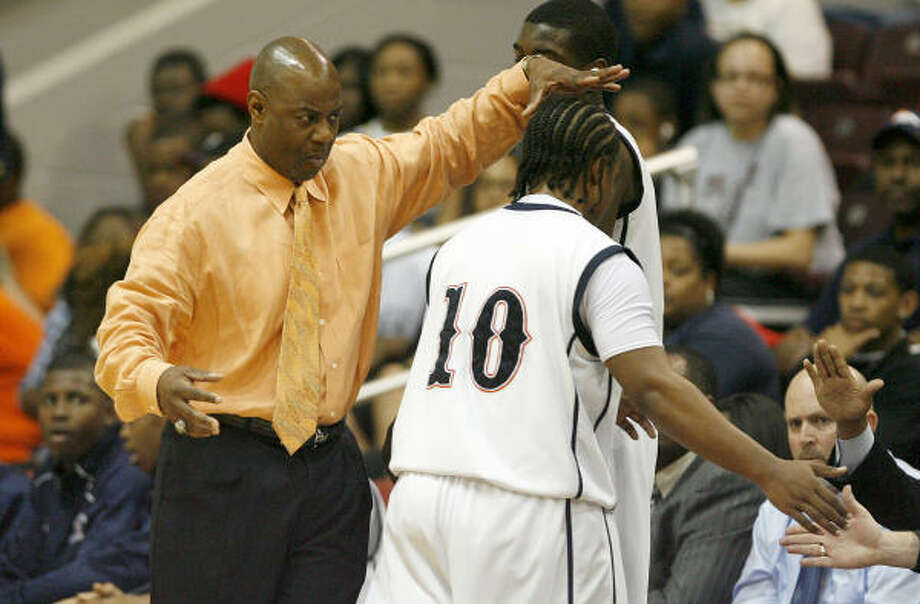 Bush basketball coach Ronnie Courtney is as fierce a competitor as they come during games. Photo: Nick De La Torre, Chronicle