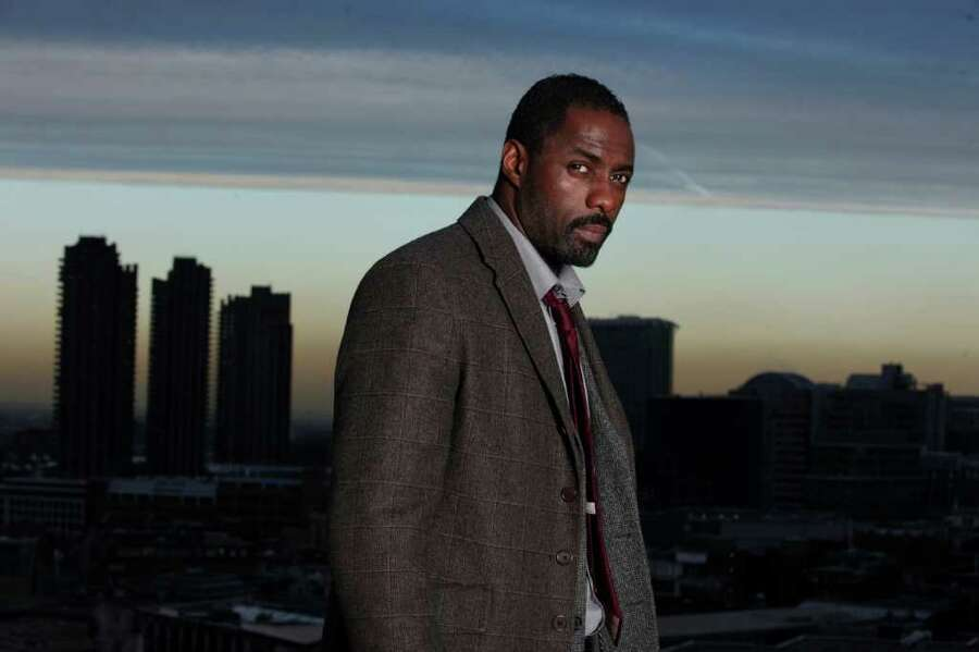 """He can act. Fans fell in love with his """"Stringer Bell"""" character on """"The Wire"""" and have followed him ever since, even as he played the brooding John Luther in BBC America's """"Luther."""" In 2011, he won a Golden Globe for """"Luther.""""  Photo: BBC / © BBC 2010"""