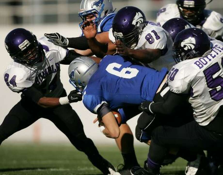 The Humble Wildcats' defensive front combined for 20 sacks last season. Photo: ERIC CHRISTIAN SMITH, For The Chronicle