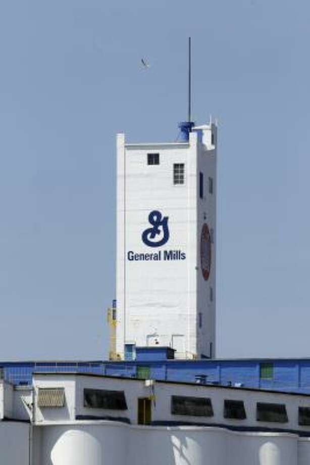 """General Mills makes the top-selling U.S. cereal brand at its waterfront complex in Buffalo, N.Y., inspiring T-shirts that say, """"My city smells like Cheerios."""" Photo: David Duprey:, Associated Press"""