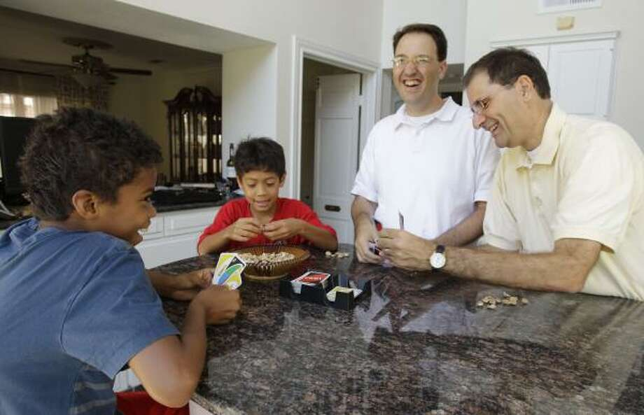Stephen, center, and Joe Milano, with adopted sons Ruben, 10, left, and Alex, 8, are proof that the American family is changing. Photo: Melissa Phillip, Chronicle