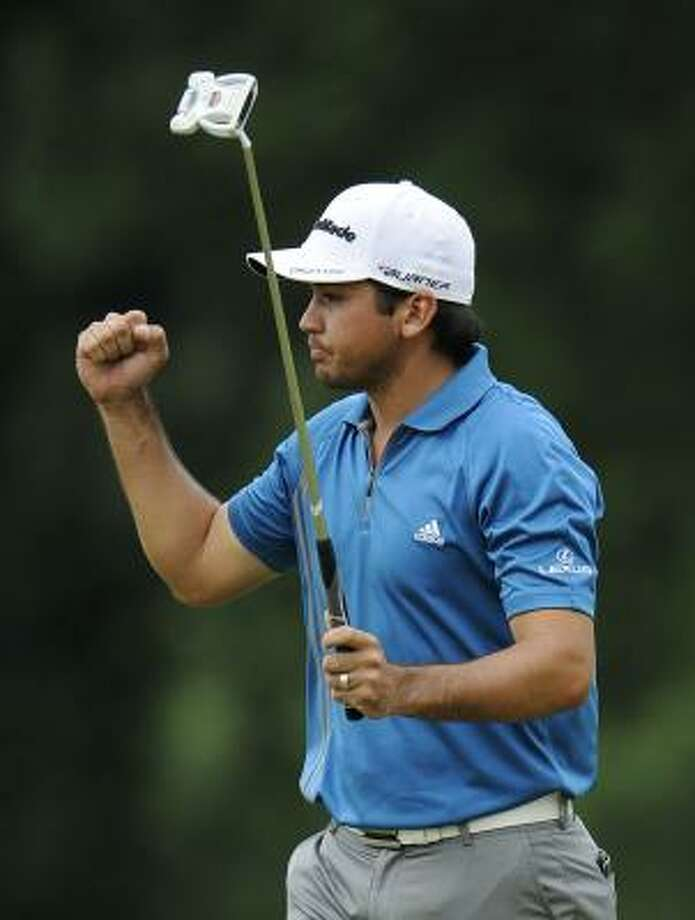 Jason Day walks off the 18th green pleased with the 6-under 65 that lifts him into a tie for third place. Photo: Nick Wass, Associated Press