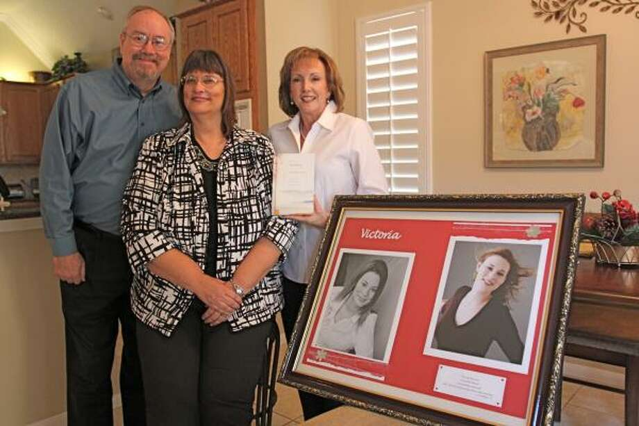 'MISERY TO MINISTRY': Brian and Leah Foutz of New Ulm started a ministry after their daughter, Victoria, was murdered in 2004. Janice Harvins-Hamric, right, helped them write a book about their daughter and ministry. Photo: Suzanne Rehak, For The Chronicle