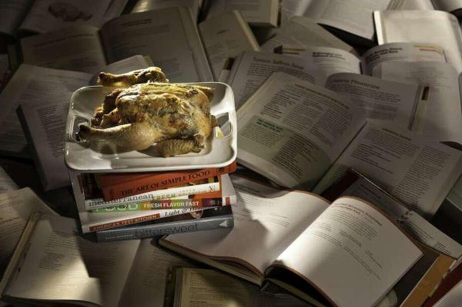 Food writer Amanda Gold cleaned off her bookshelves by evaluating the recipes in each. Photo: Craig Lee, San Francisco Chronicle