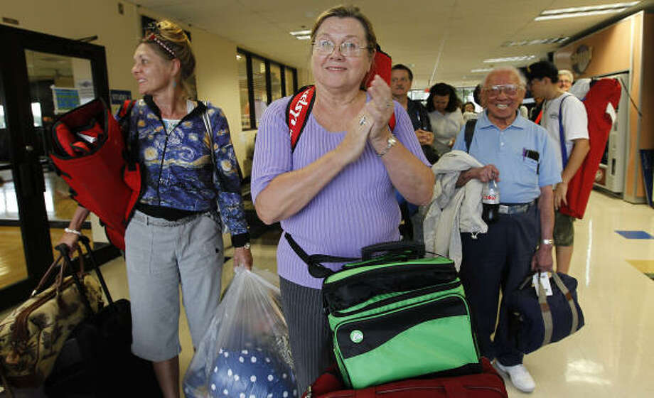 Martha Tramell, center, joins other Johnson Space Center workers at the Gilruth Center on Wednesday in Clear Lake as they prepare to travel to Florida to watch the final shuttle launch. Photo: Karen Warren, Chronicle