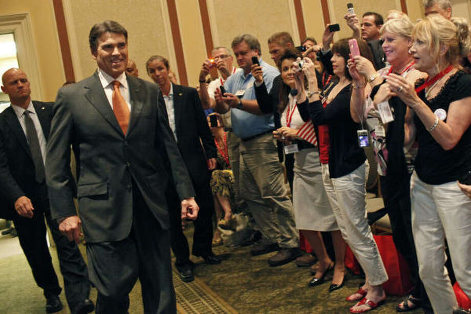 Gov. Rick Perry's campaign announcement on Saturday at Charleston, S.C.'s Francis Marion Hotel stole the spotlight as his rivals battled in the Iowa straw poll. Photo: Lisa Krantz, San Antonio Express-News