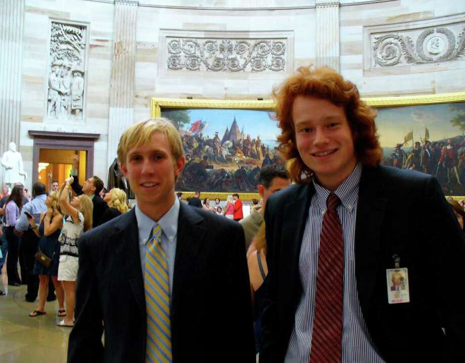 Chris Baldock, left, an intern in office of Sen. Richard Blumenthal, D-Conn., and Alex Bulazel, an intern with Rep. Mike Kelly, R-Pa., 2010 graduates from the Brunswick School in Greenwich, in the Capitol Rotunda in Washington, D.C. Photo: Contributed Photo
