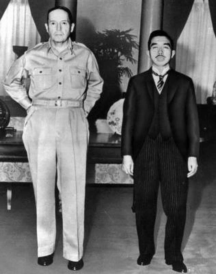 Gen. Douglas MacArthur, left, with Emperor Hirohito during the Japanese emperor's visit to the U.S. Embassy in Tokyo in 1945. Photo: ASSOCIATED PRESS FILE