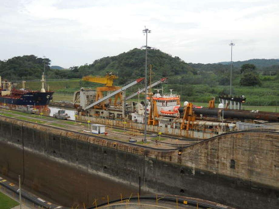 Two vessels transit the Panama Canal's Miraflores Locks. Photo: Jenalia Moreno, Chronicle