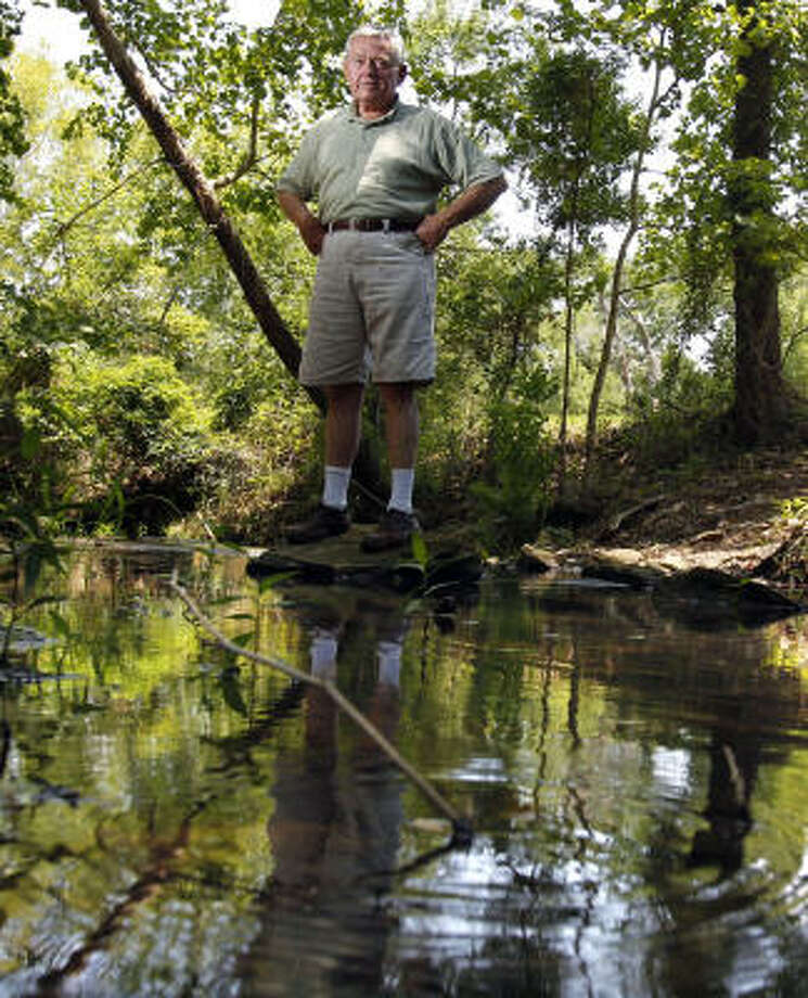 "Tom Brown retired to 30 acres along Clear Creek in Waller County. His worry: ""If this landfill goes in, it will all change."" Photo: Johnny Hanson, Chronicle"