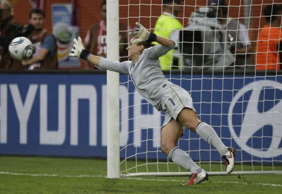 U.S. goalkeeper Hope Solo makes a save during the penalty shootout of Sunday's Women's World Cup quarterfinal match against Brazil. Photo: Marcio Jose Sanchez, Associated Press