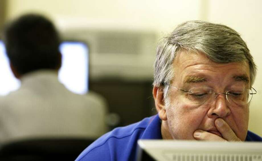 Ron Kirchoff works on a computer Monday at the Aerospace Transition Center, located in a strip mall three miles from Johnson Space Center and set up to help thousands of aerospace workers find new jobs. Photo: Cody Duty, Houston Chronicle