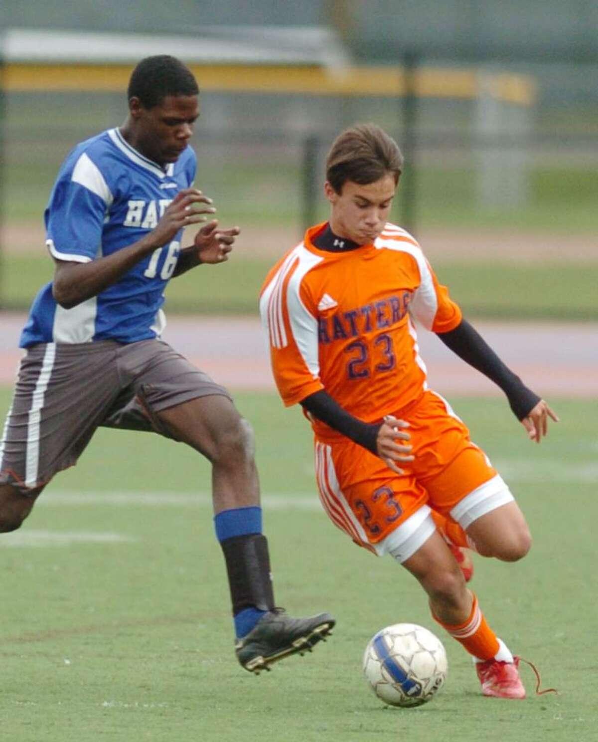 Danbury's 23, Partick De Angelo and Harding's, 16 Gavin Reid, play soccer against Harding at Danbury High Wednesday, Oct. 14, 2009.