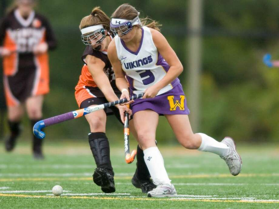 Stamford's Morgan Gulliver, left, and Westhill's Jenny Raymond, right, during an FCIAC field hockey game at Westhill High School in Stamford, Conn. on Wednesday, Oct. 15, 2009. Photo: Chris Preovolos / Stamford Advocate