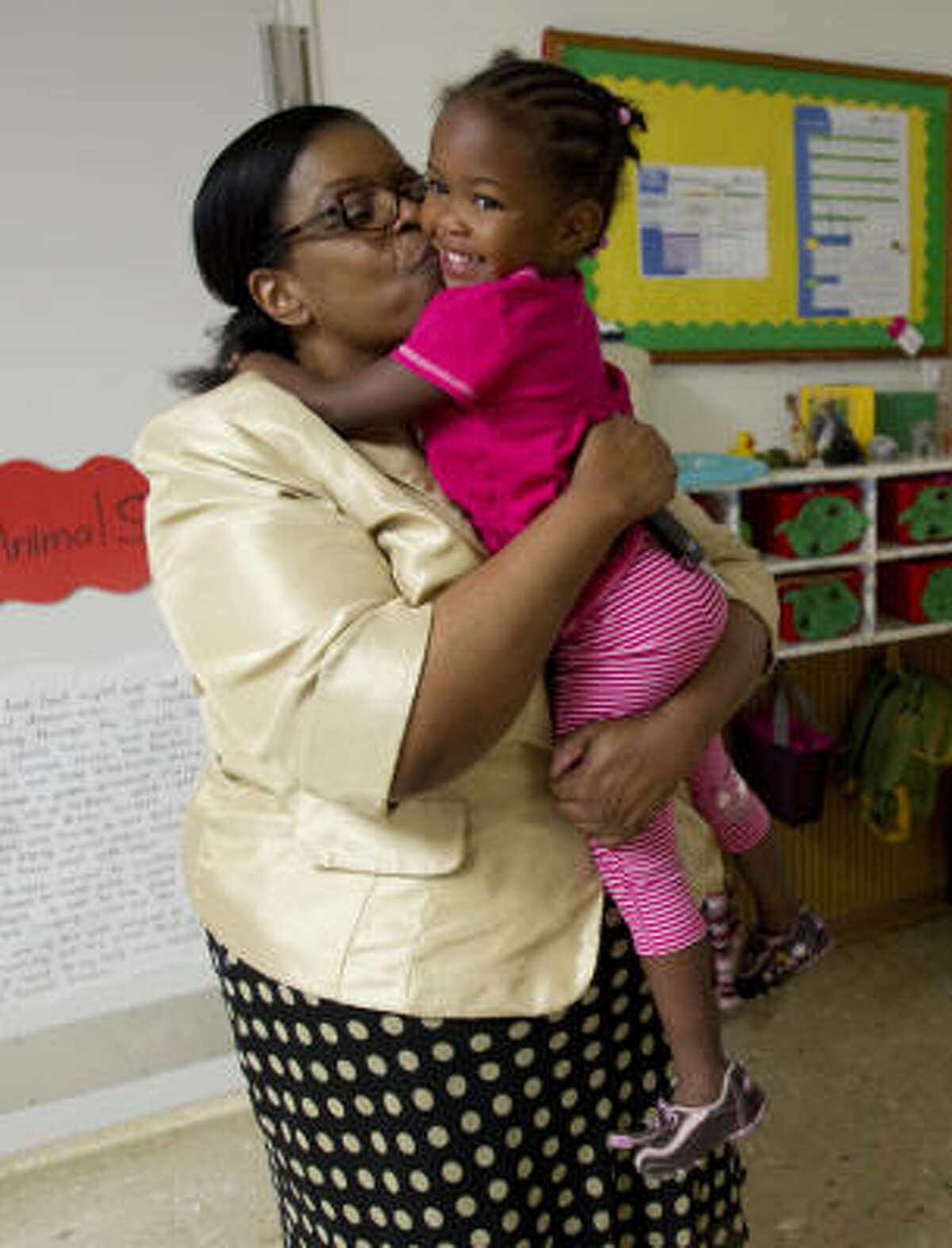 Na'Rya Brown, 2, shown arriving at her Houston day care Wednesday, joined Dorothy Martin's home just after she was born. Martin is also raising two other grandchildren.