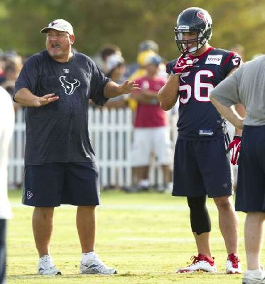 Texans linebackers coach Reggie Herring, left, works with linebacker Brian Cushing. Photo: Brett Coomer, Houston Chronicle
