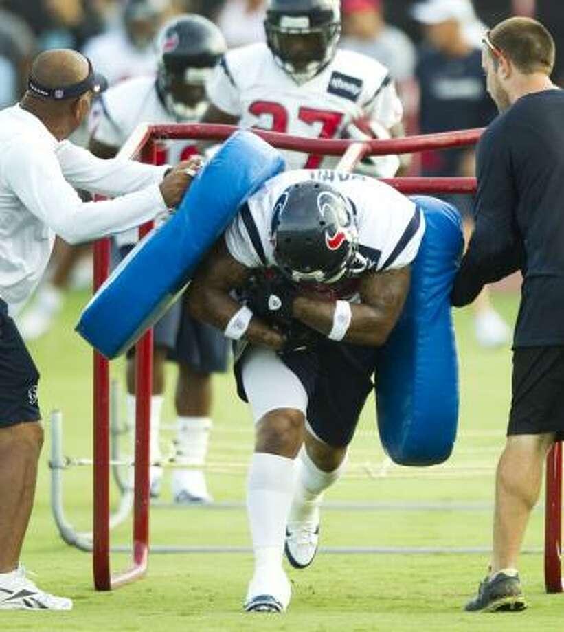 Texans running back Derrick Ward runs through a ball-carrying drill. Photo: Brett Coomer, Chronicle