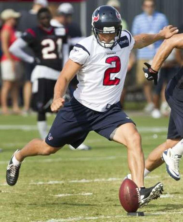 Texans punter Brett Hartman kicks off. Photo: Brett Coomer, Chronicle