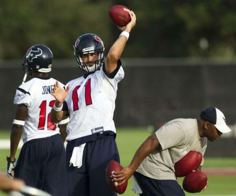 Texans quarterback Matt Leinart throws a pass as he warms up. Photo: Brett Coomer, Chronicle