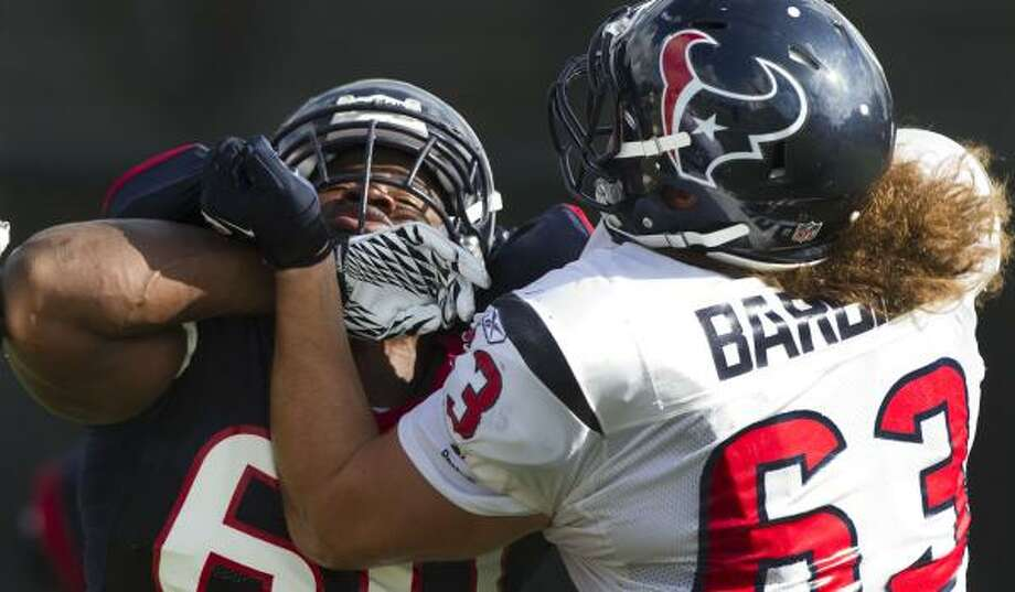 Aug. 11Texans defensive end John Graves (60) and guard Howard Barbieri (63) battle during a pass rush drill. Photo: Brett Coomer, Chronicle